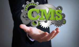 man holding a cms word